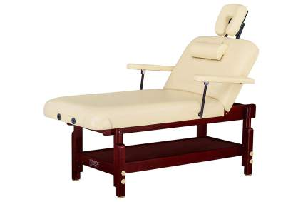 Cream stationary spa table for massage