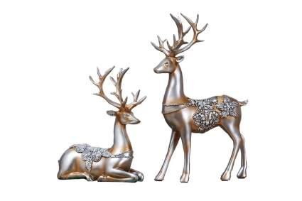 Two deer statues