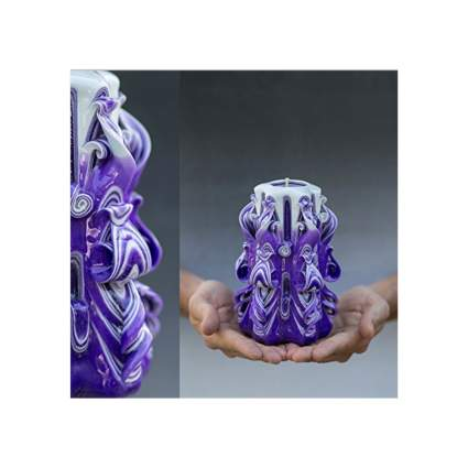 fancy handmade purple and white carved candle