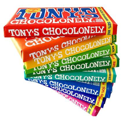 Rainbow pile of Tony's Chocolonely chocolate bars