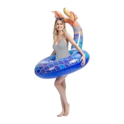 Woman with mermaid pool float