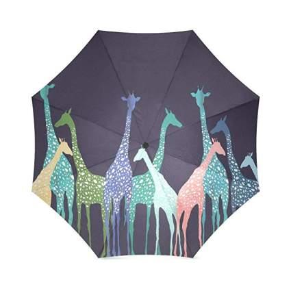 Dark umbrella with giraffes