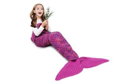 Girl in pink mermaid blanket