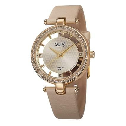 gold tone and diamond watch