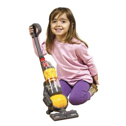 Child with play vacuum