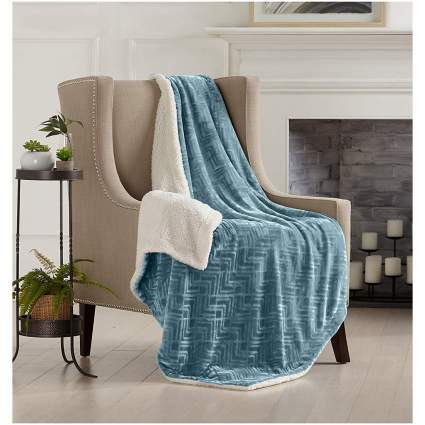 Blue and white throw on arm chair