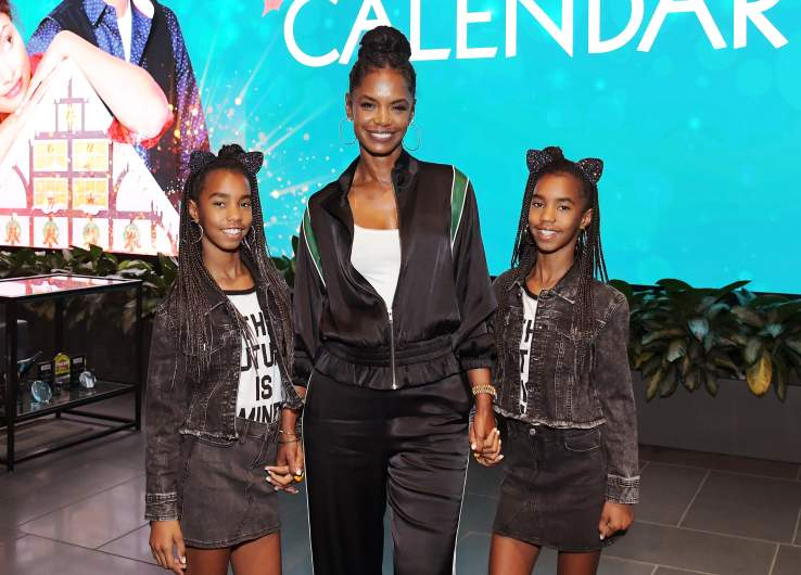 Kim Porter and her daughters