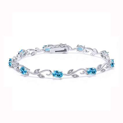 silver swiss blue topaz and diamond tennis braclelet