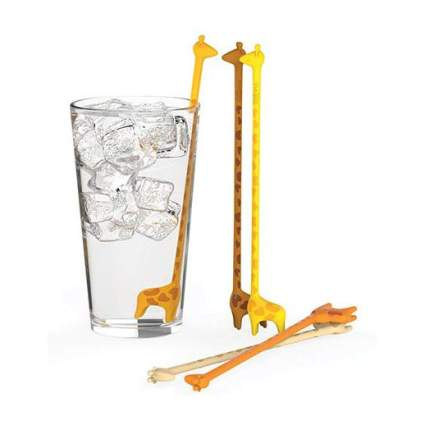 Glass of water with giraffe shaped drink stirrer