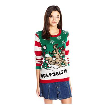 Woman in tacky christmas sweater