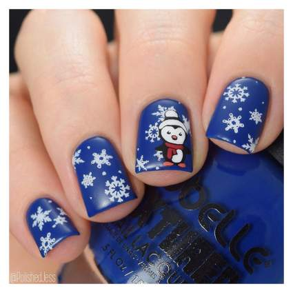 Christmasy nails with penguins