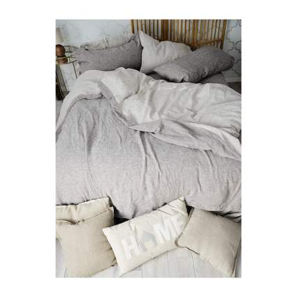 Grey linen sheet set on bed