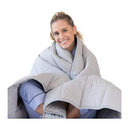 Woman with weighted blanket