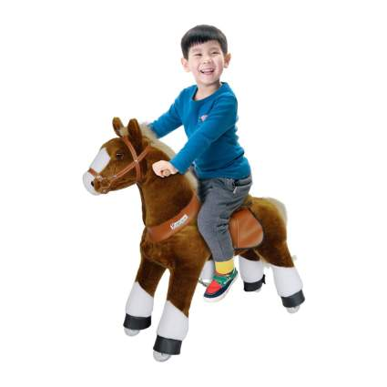 Young boy on riding PonyCycle toy