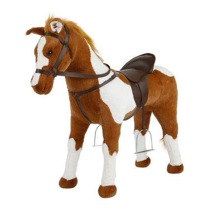 Tan and white riding plush horse