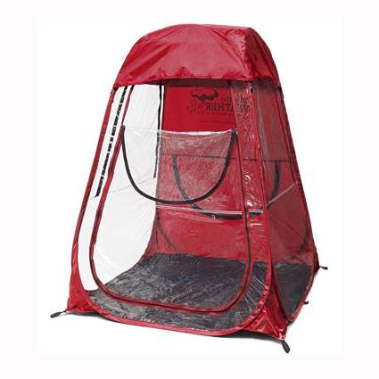 red pop up on person pod tent
