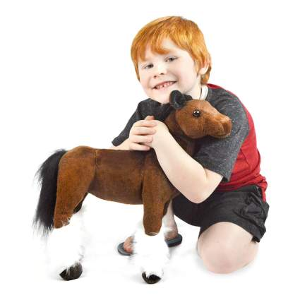 Boy with horse stuffed animal