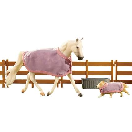 Toy horse with toy dog and fencing