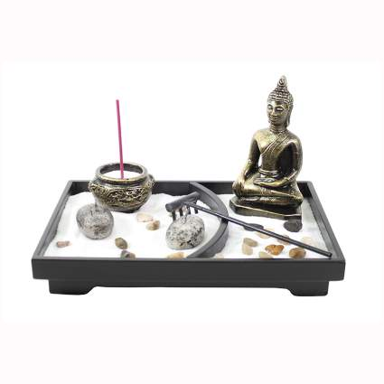 tabletop zen garden with buddha and incense burner