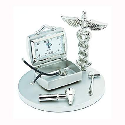 silver tone desk clock with caduceus