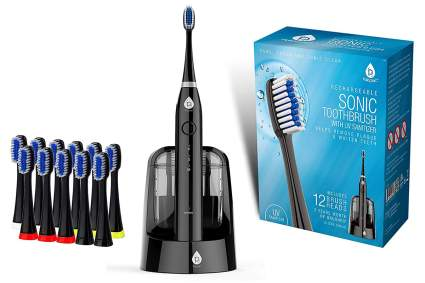 Black electric toothbrush with replacement heads