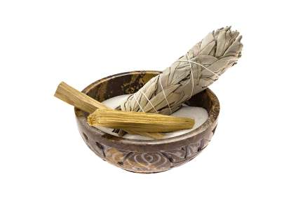 Soapstone bowl of sand with sage and sticks