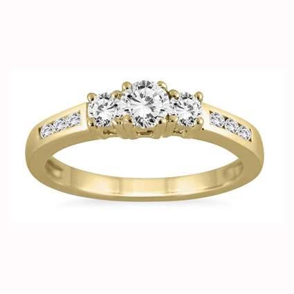 gold and diamond three stone ring