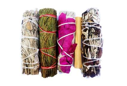 Four bundles of sage and herbs