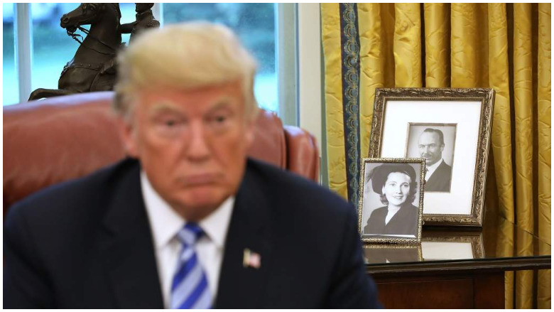 who is in photos behind trump
