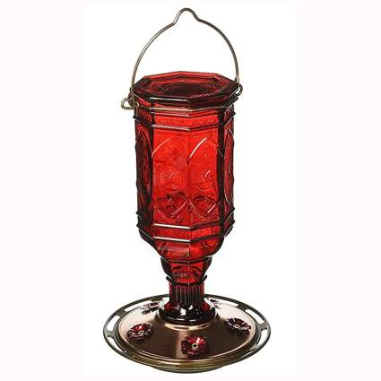red antique glass hummingbird feeder