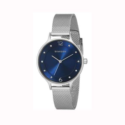 silver tone watch with a blue dial