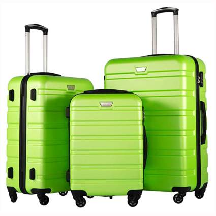green three piece hardside spinner luggage set
