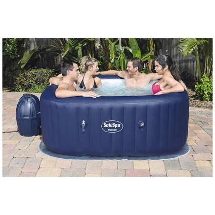 dark blue inflatable spa with four people