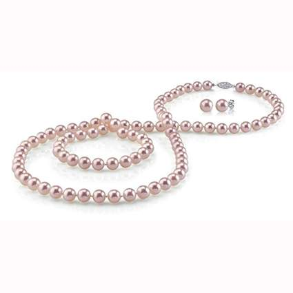 pink opera length pearl necklace and stud earrings