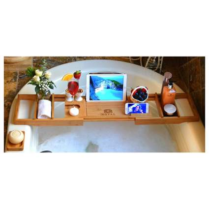 Wooden bath tray with wine glass and tablet