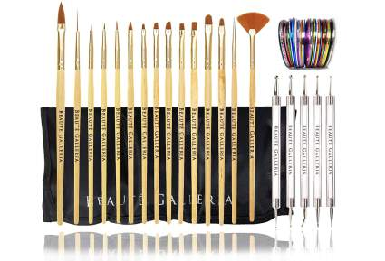 set of paint brushes and nail art tools