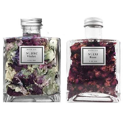 Flower infused bath oil bottles