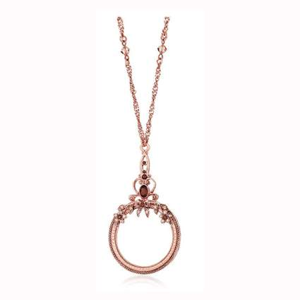 copper tone and crystal magnifying glass necklace