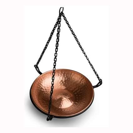 hammered copper bird bath with black iron holder