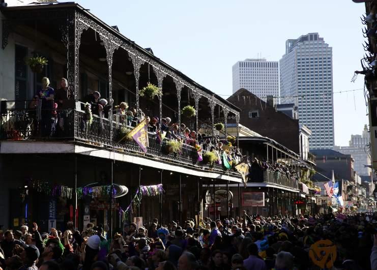 Revelers pack Bourbon Street during Mardi Gras day in 2016.