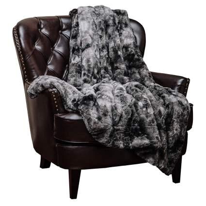 cozy throw blanket on an arm chair