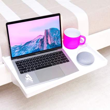 white shelf on bedside with laptop