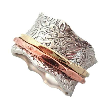 silver ring with brass and copper spinners