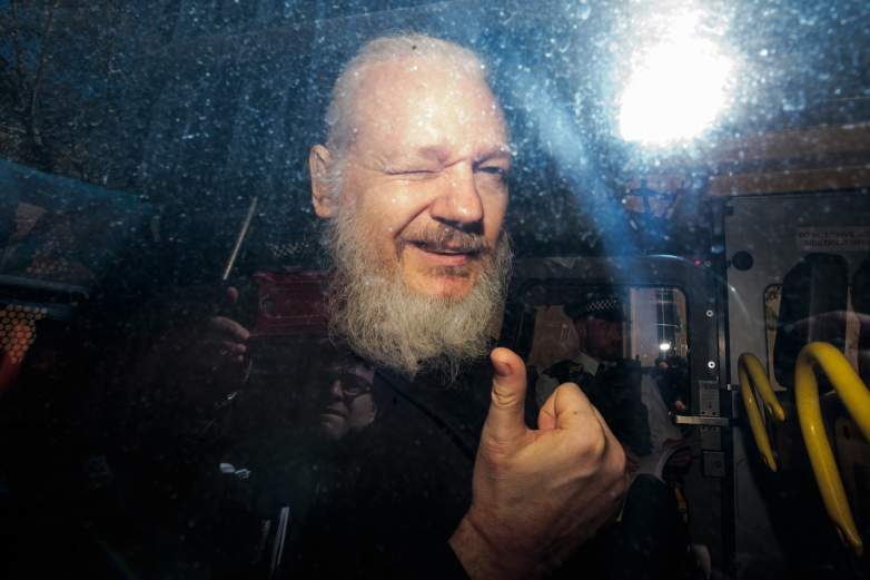 Julian Assange thumbs up
