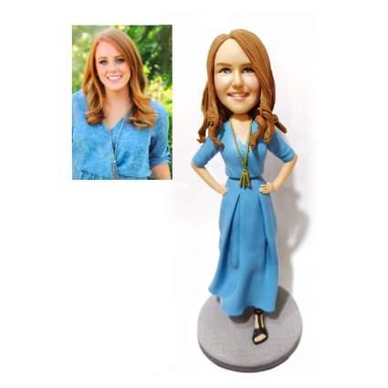Bobblehead of woman in blue dress
