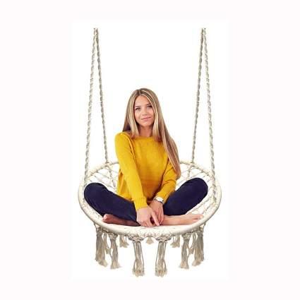 white hanging macrame swing