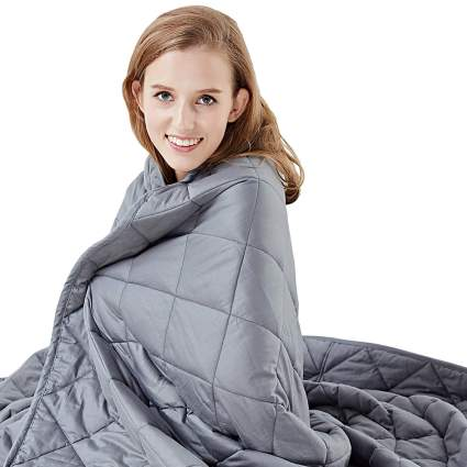 Woman with grey blanket