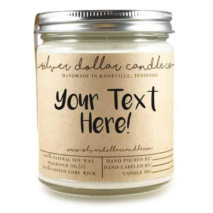 """tan candle in jar that says """"Your text here"""""""