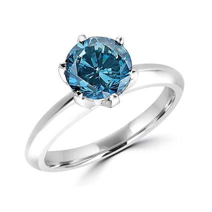 white gold and blue diamond solitaire ring