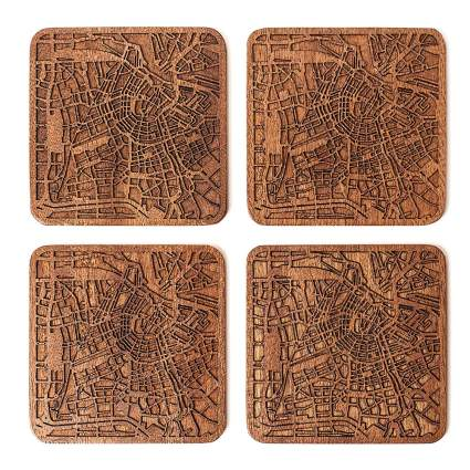 Set of four cork coaster with roadmaps